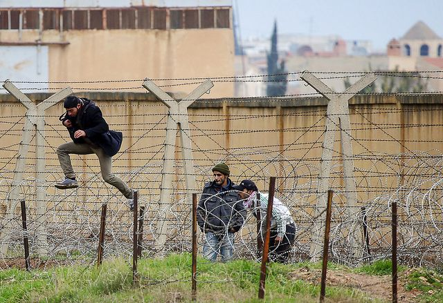 Syrian man jumping the border by https://www.flickr.com/photos/syriafreedom/