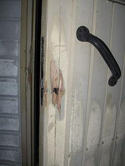 Broken Door By SeppVei (Own work) [Public domain], via Wikimedia Commons